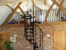 Traditional Spiral Stair with matching landing balustrade