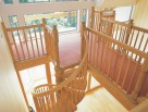 Wooden Spiral Stair with matching landing balustrade