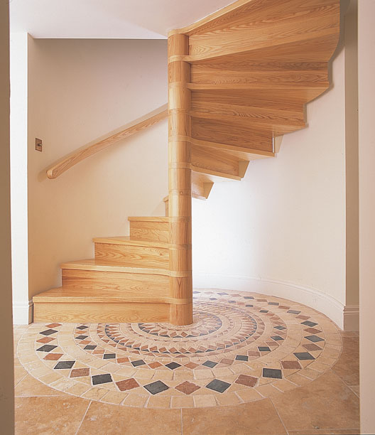 Spiral Staircase With Closed Risers And A Handrail Hung From The Wall Known  As The Burke Style