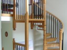 Simple and elegant solid timber spiral staircase with plain metal balustrade