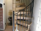 Wooden Spiral Stair with metal balusters and metal handrail to spiral
