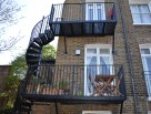Double Flight LCC Balcony with Matching Spiral Staircases