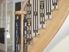 Helical staircase with metal balusters