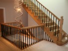 Straight wooden staircase with metal balusters