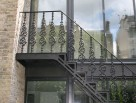 Elegant Staright Staircase with Cast Iron Balusters