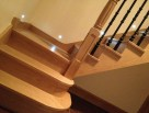 kited wooden staircase metal balustrade