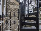 Victorian Spiral Stairs with Ornate Balusters