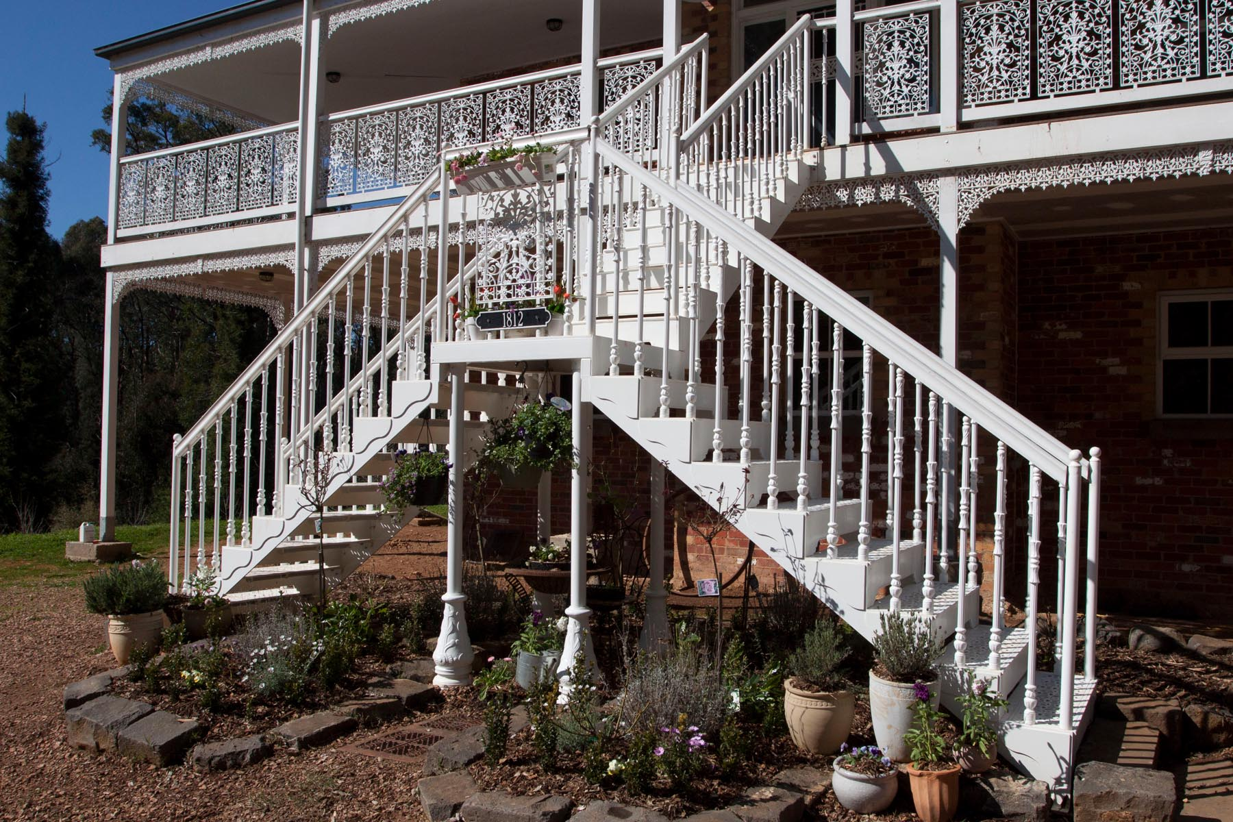 white Victorian exterior staircase