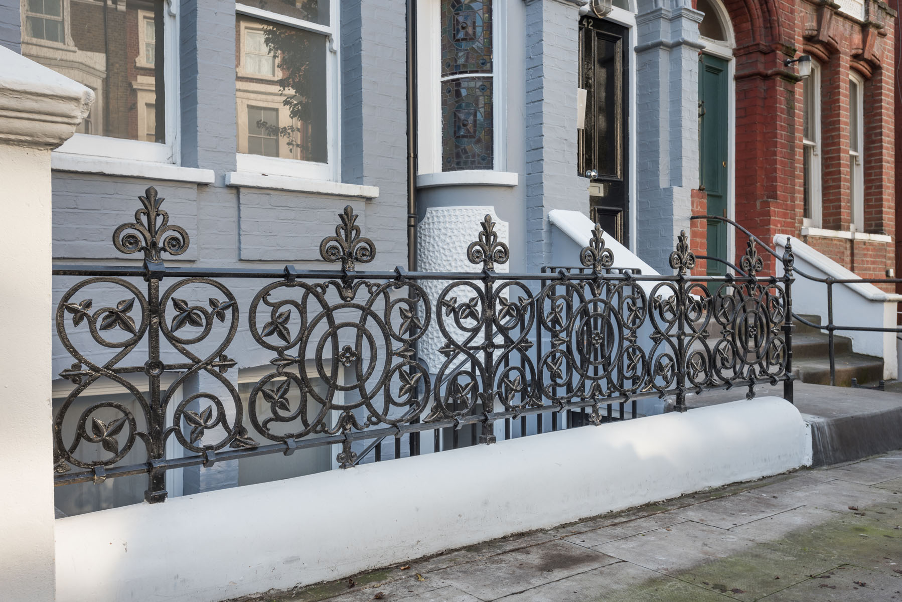 Cast iron wall top railing in london
